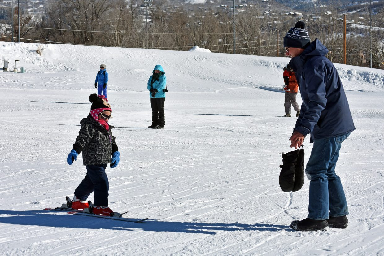 First-time skier Hailey Andrew glides toward her father, Tyler Andrew, at Ski Free Sunday on Howelsen Hill. Howelsen is scheduled to hold Ski Free Sunday every Sunday until mid-March, with limited terrain open on Dec. 9 and 16 as the hill hosts snow sport events.