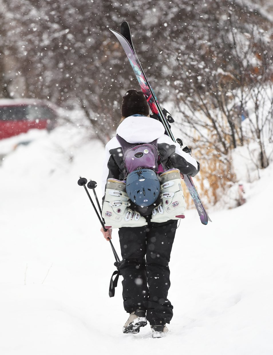 Skier Seana Carrigan heads for home  in the Fairview neighborhood after what she described as an awesome day on the mountain at the Steamboat Resort.