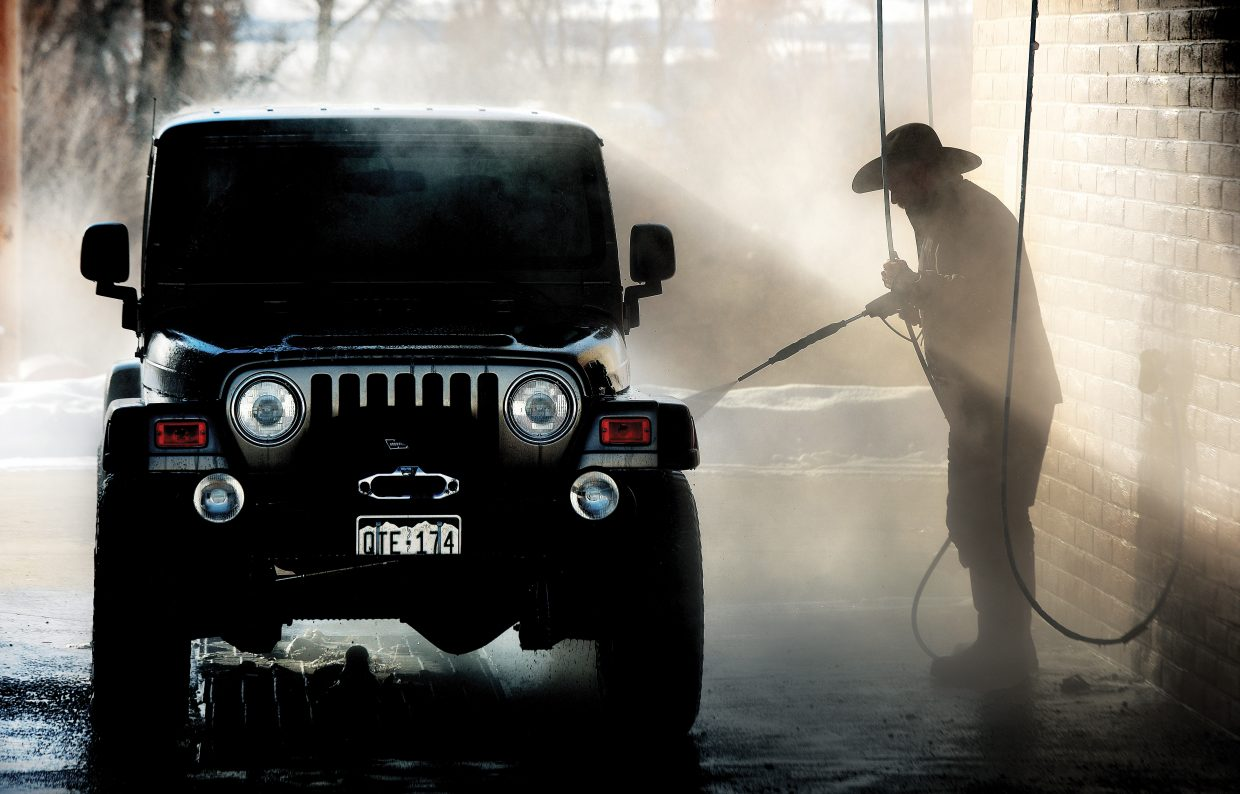 Paul McKee of Steamboat Springs took advantage of Monday's mild weather to clean some of the dirt off of his jeep.
