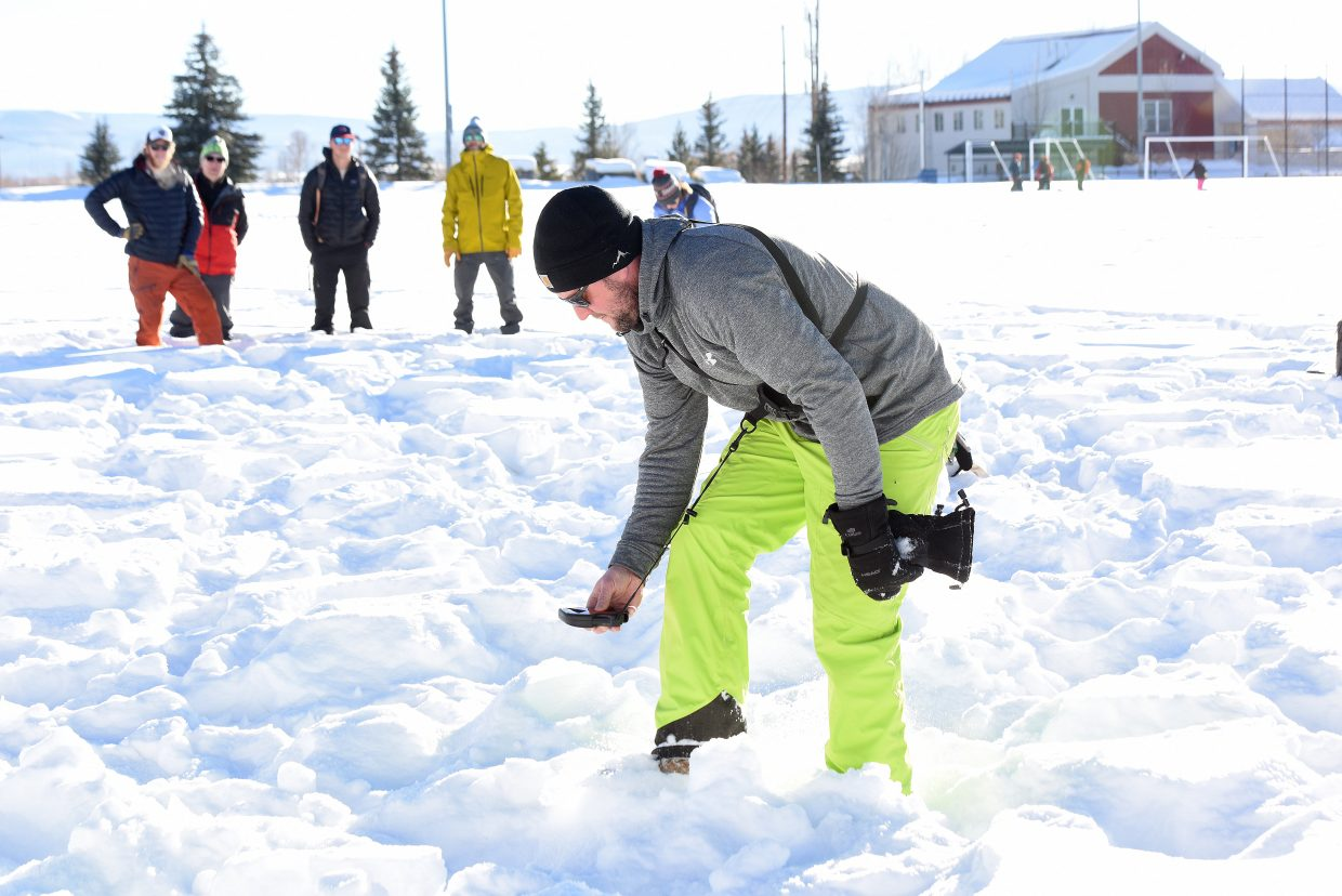 Shawn Lowe uses a beacon to find another buried in the snow during a n AIARE (The American Institute for Avalanche Research and Education) level 1 avalanche class offered by Steamboat Powercats. The classes took place on the Ski Town Fields.