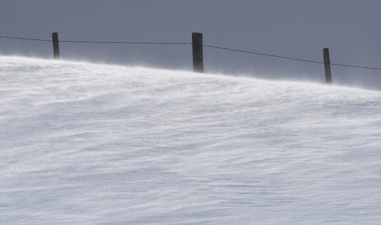 Snow blows across the ground just off of Routt County Road 33 west of Steamboat Springs Thursday. The sun came out in the afternoon, but wintery conditions persisted through much of the day.