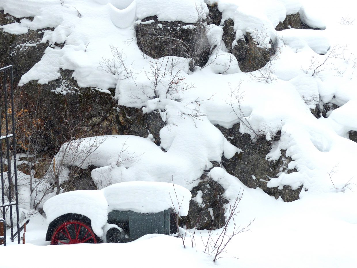 This tractor is buried in the snow, near the base of the Fish Creek Falls parking lot. At least I think it is a tractor.