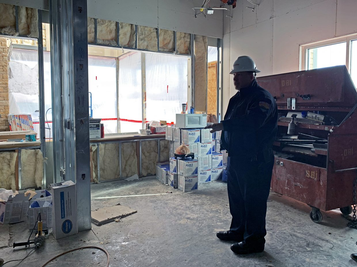 Steamboat Springs Police Chief Cory Christensen stands in what will soon be the lobby and police records department of the new Combined Law Enforcement Facility. Construction on the project is ahead of schedule and on budget. Police and Routt County Sheriff's Office offices will be integrated in the new building — police commanders' offices will be next to the undersheriff's. The agencies will share meeting space, locker rooms and more.