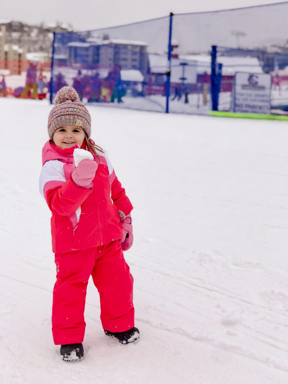 Nora, 3, from Texas, learns how to properly form a snowball.