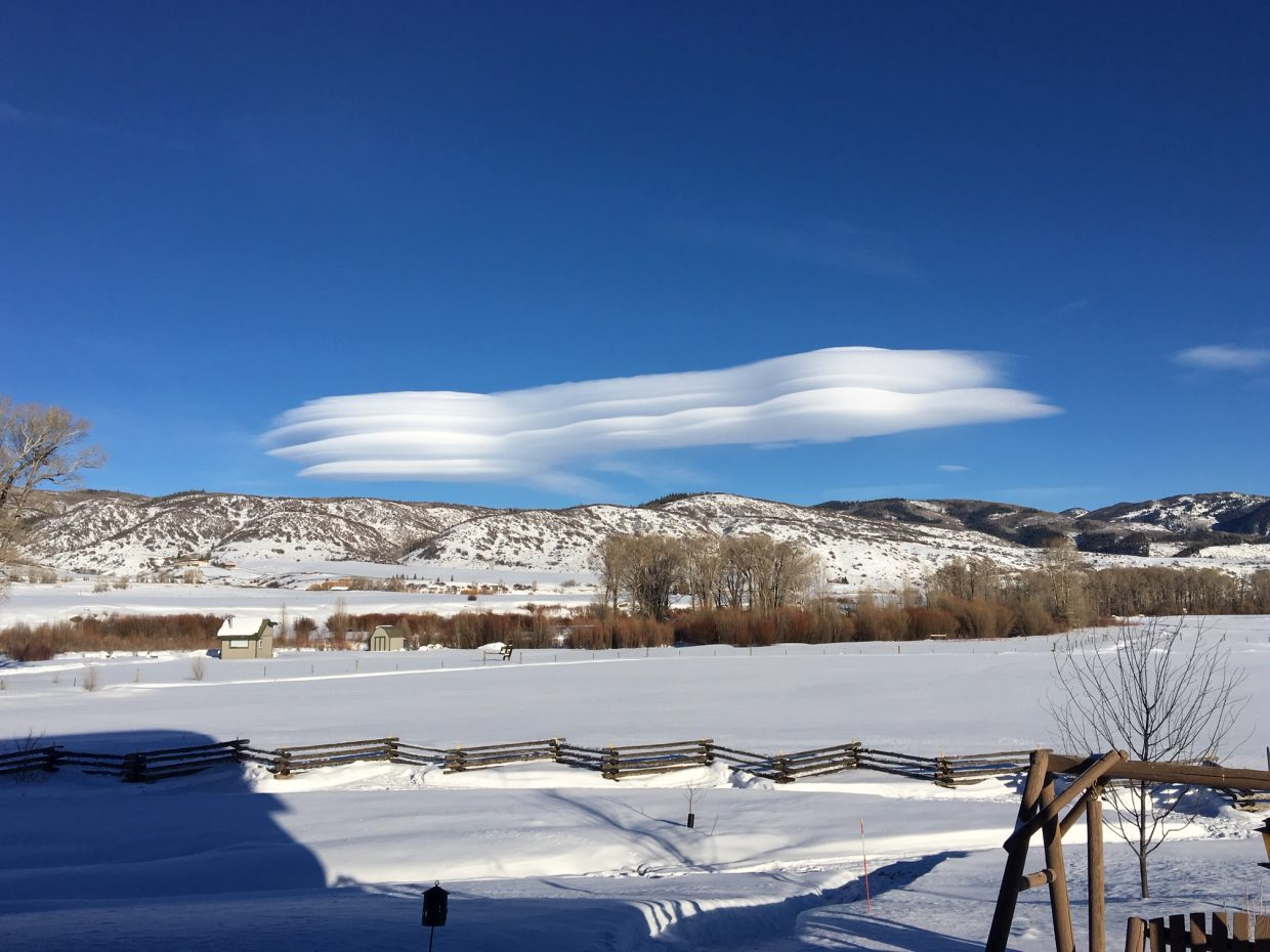 Clouds shaped like spaceships float over the Elk River.