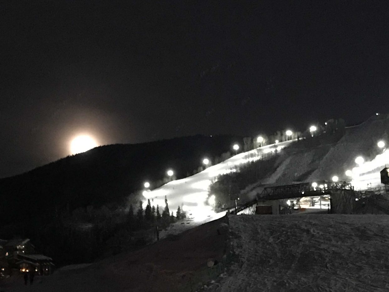 The Super Moon peaks over the edge of Steamboat Resort.