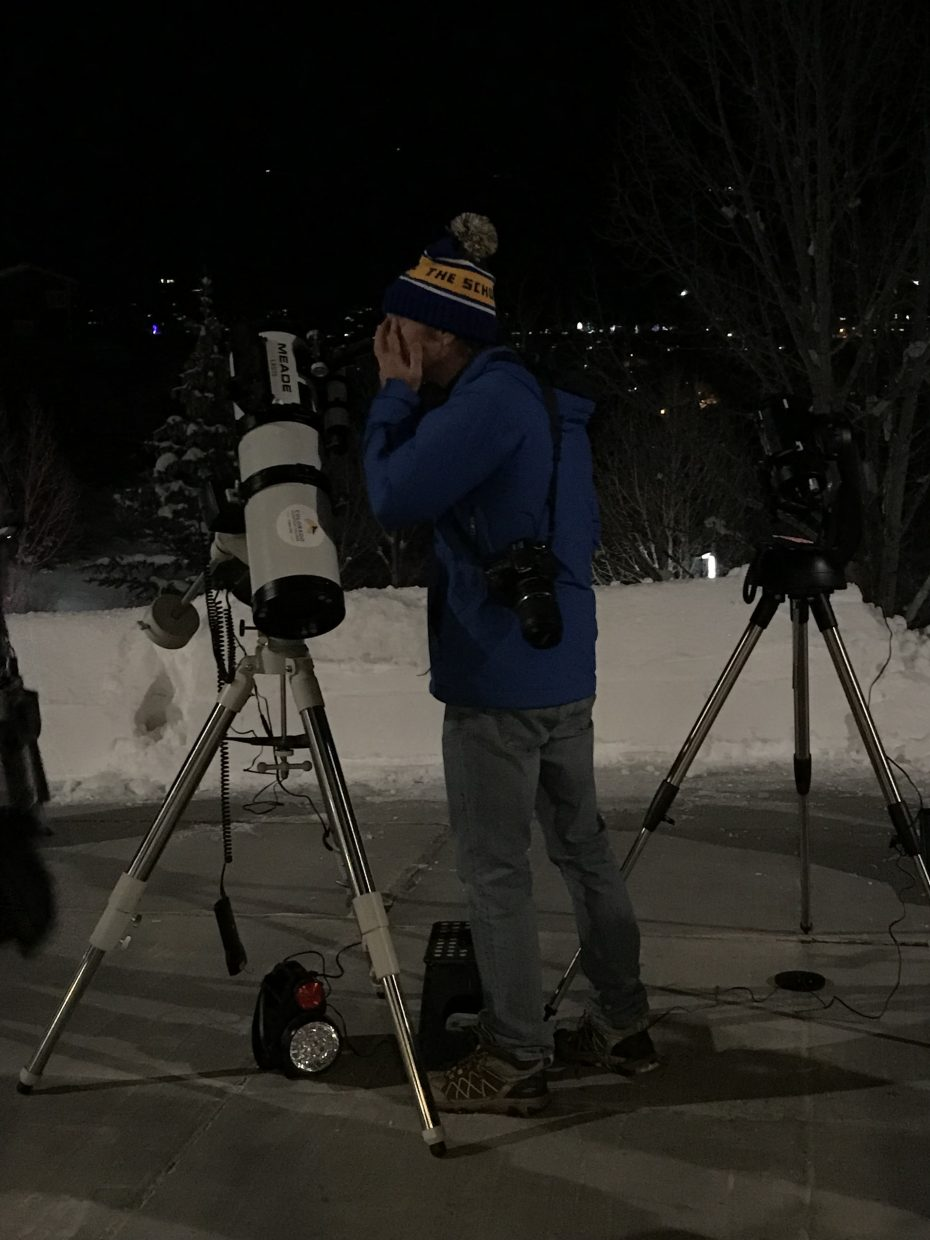 A student looks through a telescope at Colorado Mountain College's Sky Club viewing party of the Super Blood Wolf Moon.