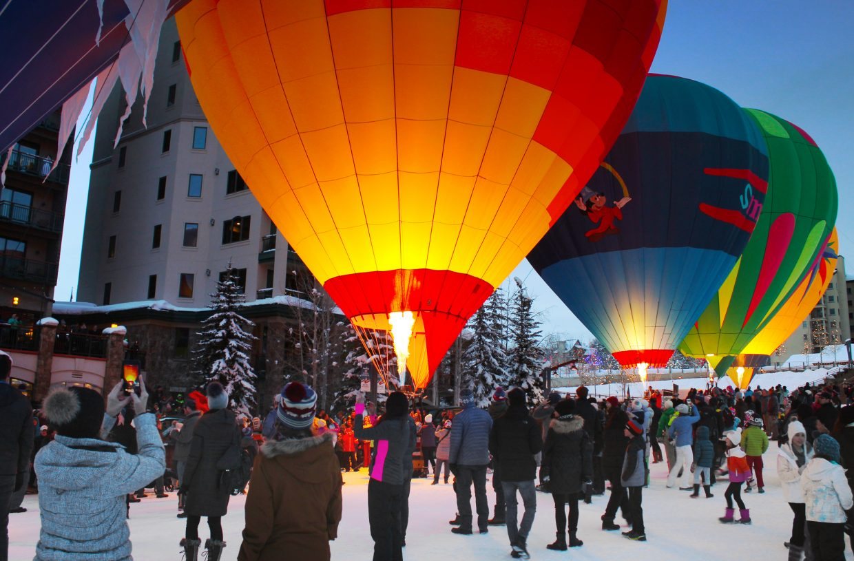 Spectators gather at Steamboat Resort to watch the Balloon Glow on Sunday.