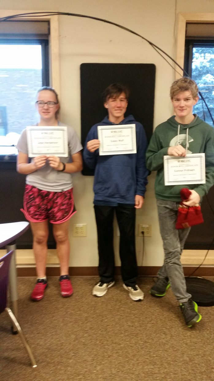 SSMS Students Jade Henderson, Casey Wolf, and Connor Frithsen display their American Mathematics Competition 8 Honor Roll Certificates. The Honor Roll recognizes students who placed in the top 5% nationally.