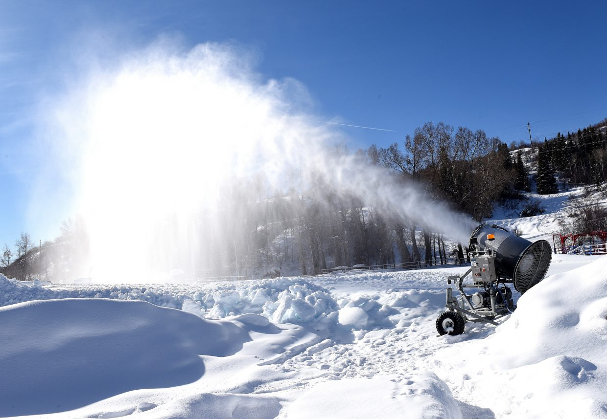 A snowmaking gun at the base of Howelsen Hill Ski Area was running hard Tuesday morning as crews make, and stockpile snow for the upcoming Steamboat Springs Winter Carnival.
