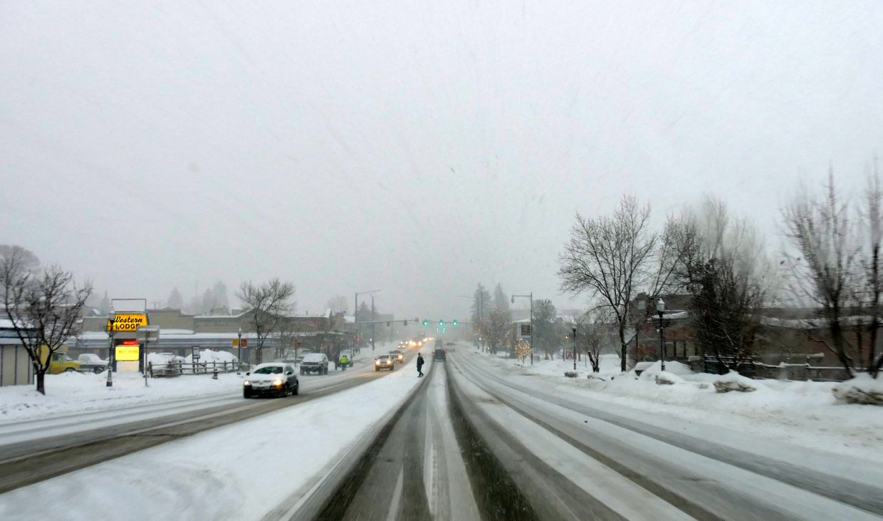Snow came down hard in Steamboat Springs Sunday and Monday, covering everything in sight.