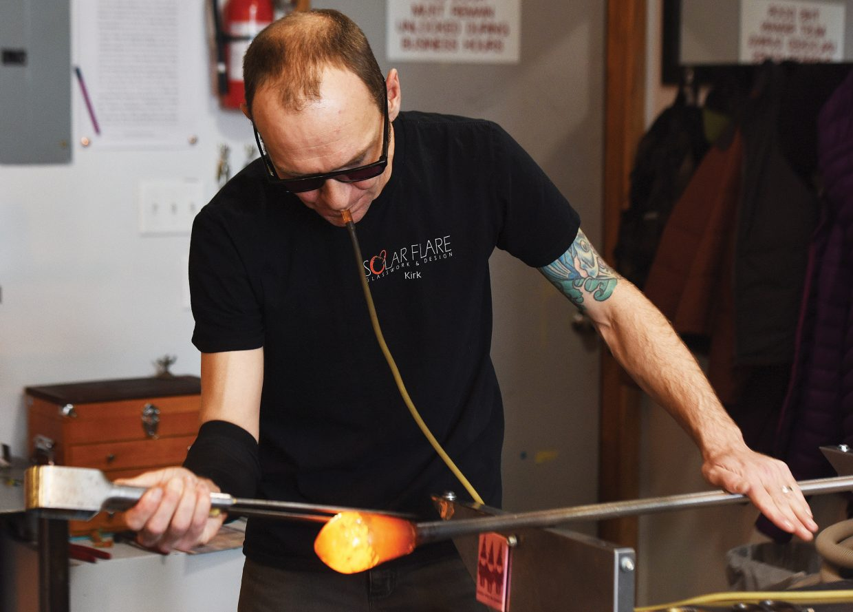 Kirk Whitten creates a pint glass in the recently opened Solar Flare Glasswork & Design.