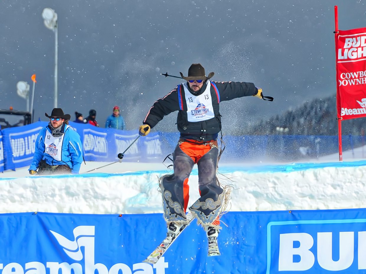 A cowboy takes a leap at the 45th annual Bud Light Cowboy Downhill at Steamboat Resort.