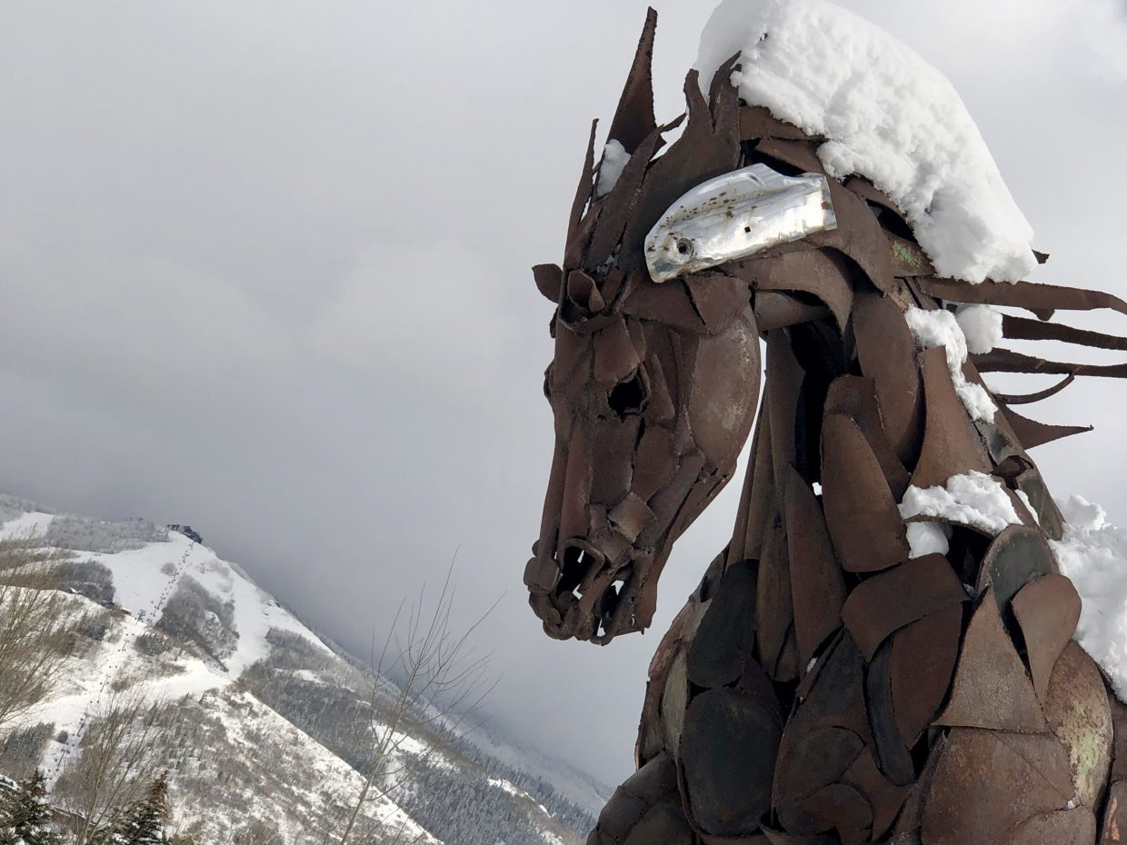 The horse statue at Wildhorse Plaza soaks up a little sun to melt its snow-covered main.