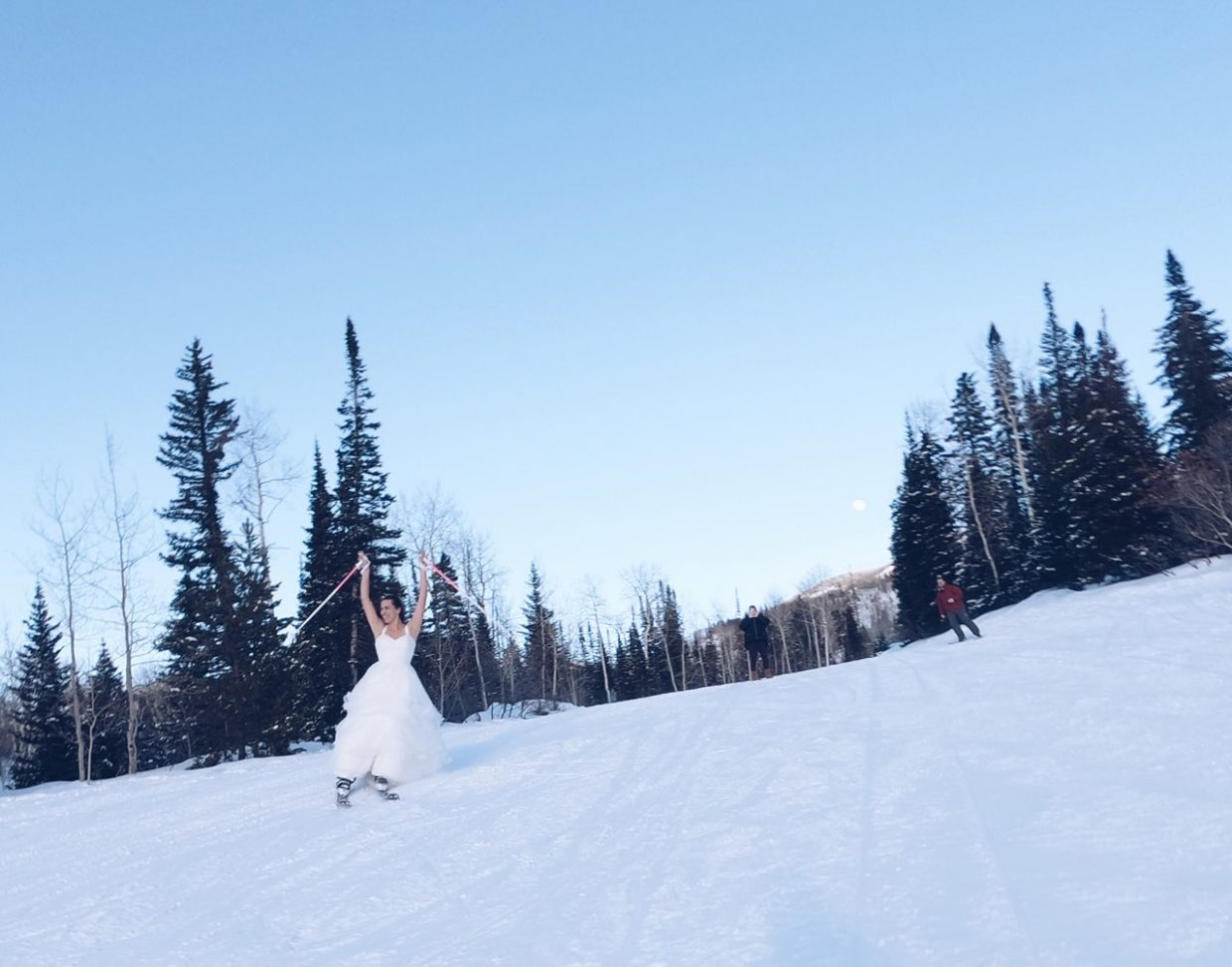 Love was found on the mountain this Valentine's weekend for Becky and Andrew Hill from Fort Collins, who were married last summer. Becky is getting the most out of her wedding dress and decided 22 degree temps would not stop her from skiing down the slopes.