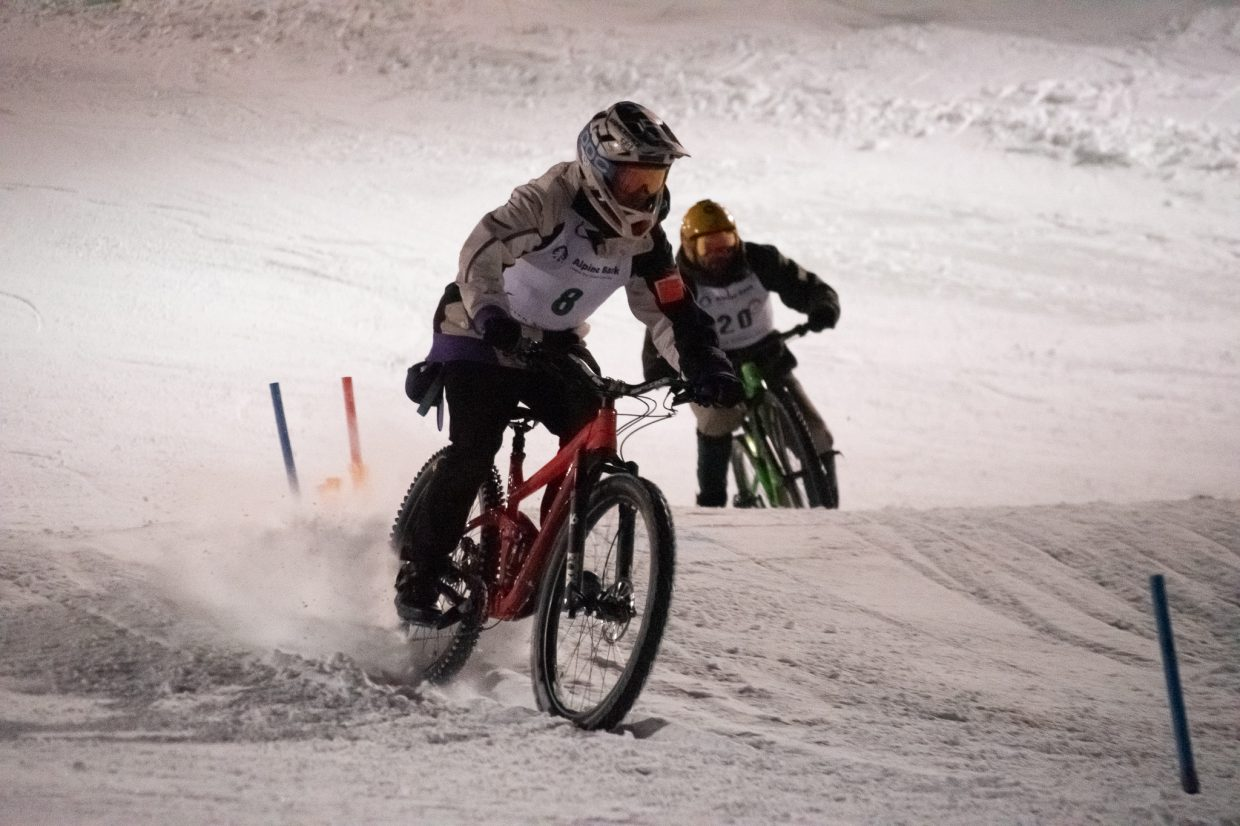 Two riders fighting for the lead in the slalom mountain bike race down Howelsen Hill Face.