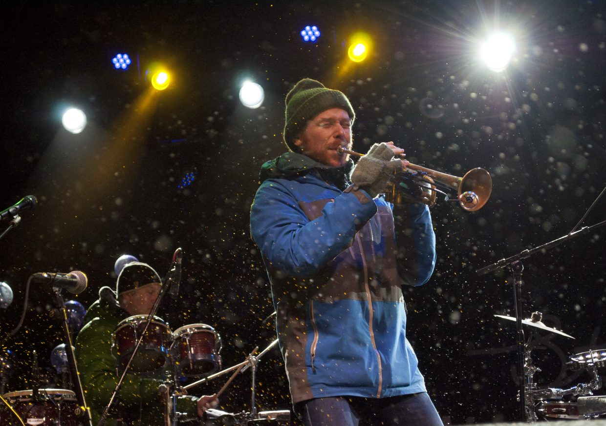 Lech Wierzynski, of the California Honeydrops, powers through the cold and snow to play main stage Saturday night at WinterWonderGrass in Steamboat Springs.