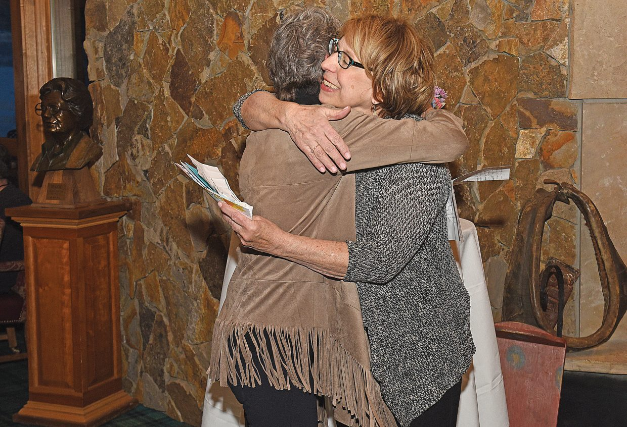 Jan Fritz, director of cancer services at UCHealth Jan Bishop Cancer Center, hugs Jane Howell, who won the award in 2017, after she spoke as part of the Hazie Werner Award presentation Thursday night at Haymaker Gold Course. Fritz was named the 2019 recipient. Fritz was the 31st women to win the award, which is named after the legendary Hazie Werner.