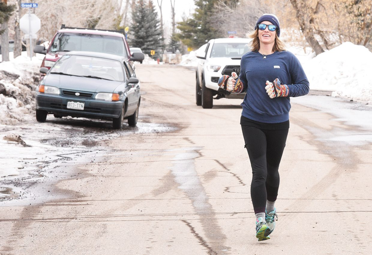 Leigh Rushton makes her way down Logan Avenue while jogging in downtown Steamboat Springs Thursday afternoon.