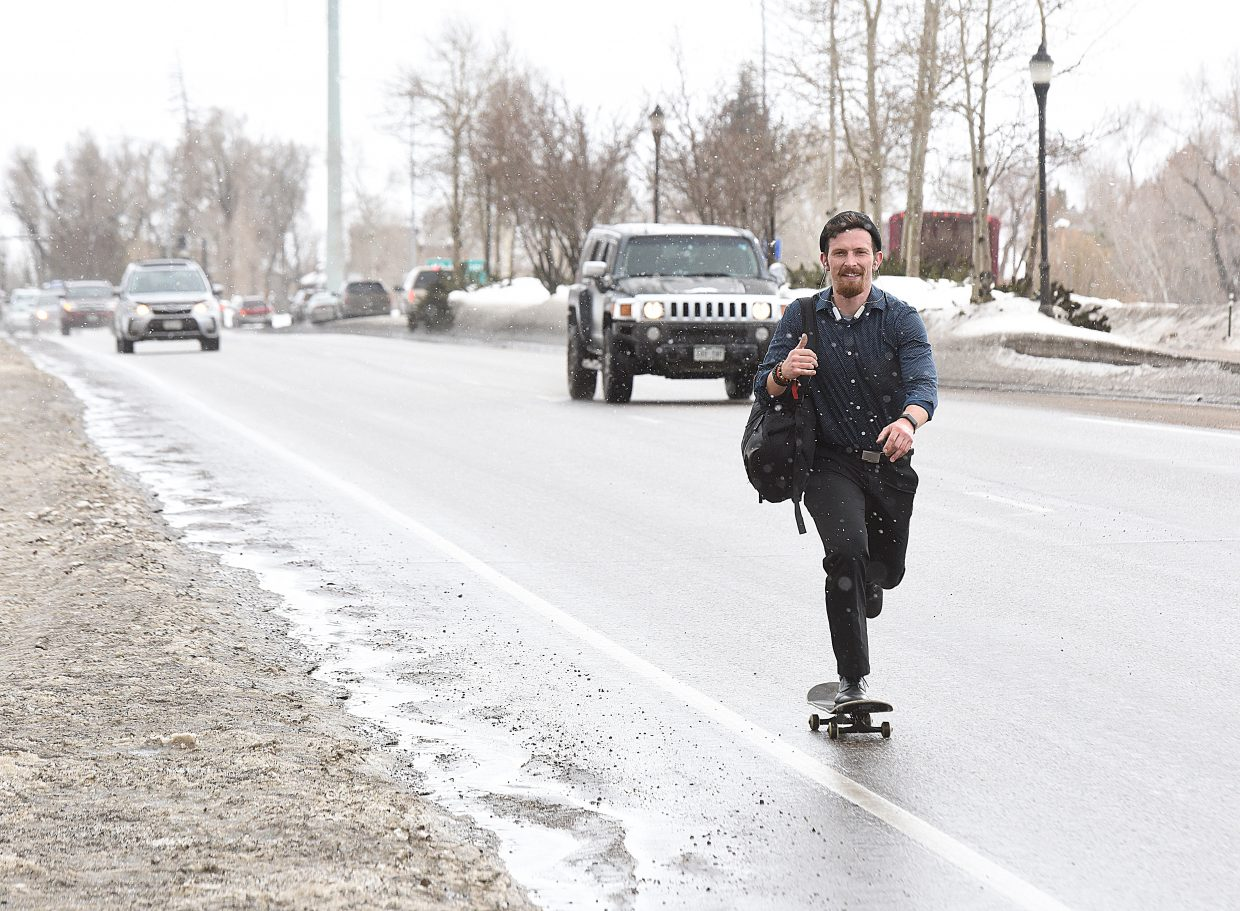 Austin Cariveau  uses his skateboard to commute home from  a job interview Tuesday afternoon in Steamboat Sprongs. Cariveau just recenlty moved to Steamboat Springs, and said his skateboard is a great way to get around town when the streets are not coated in snow.