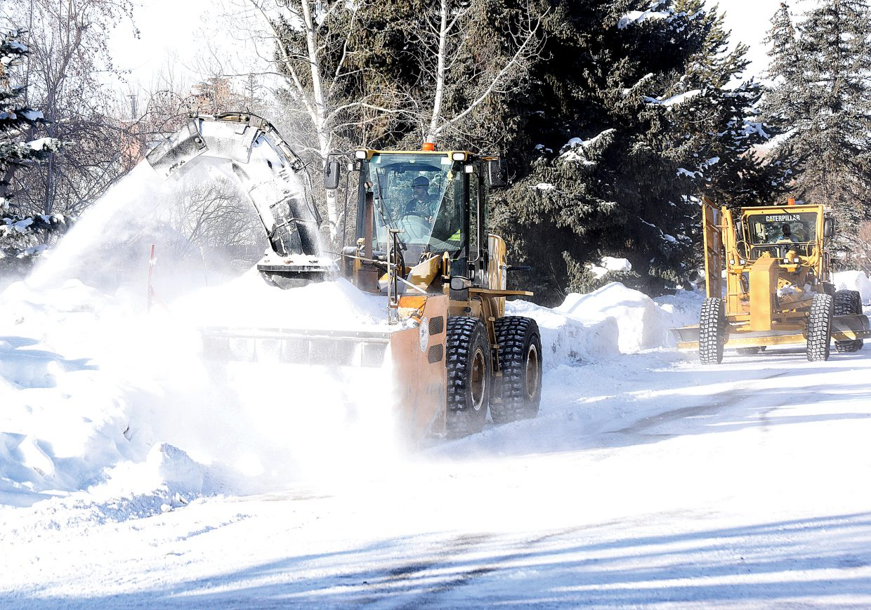 Crews from the City of Steamboat Springs use a snowblower to push back the berms left behind by regular snowplowing.