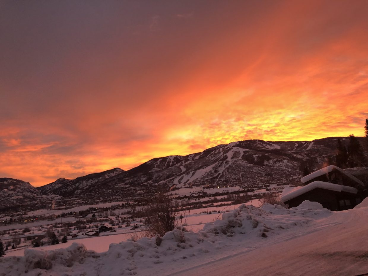 The sun rises over Steamboat Springs.