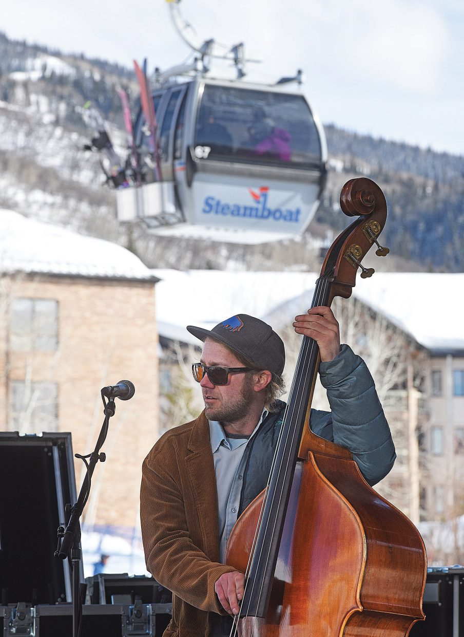 Buffalo Commons bass player Denton Turner performs for the crowd at the base of the Steamboat Ski Resort Thursay afternoon. The local band was the first to take the stage for this year's WinterWonderGrass music festival that will be taking place all weekend at the Steamboat Resort.