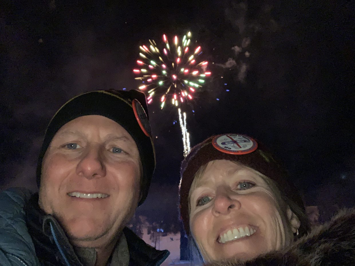 A selfie finds itself well-timed during the Nighttime Extravaganza during  Winter Carnival.