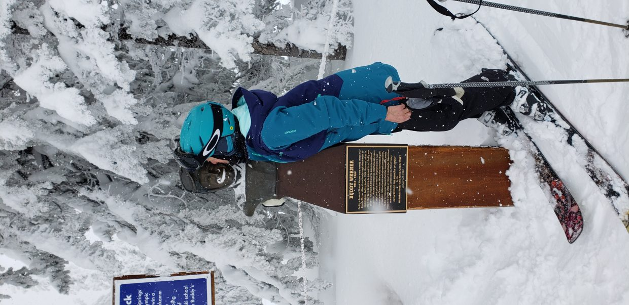 A skier kisses Buddy Werner's statue at Steamboat Resort.