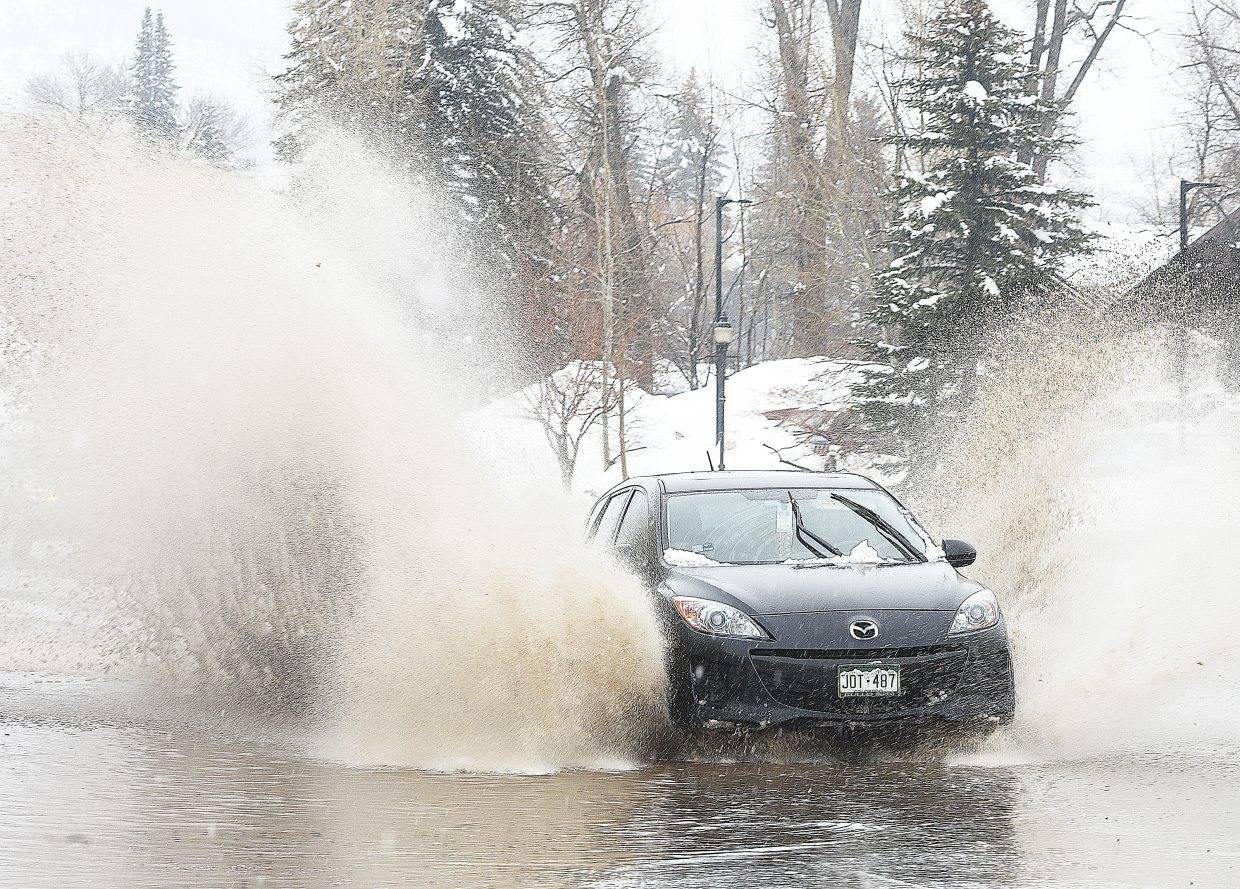 Driving conditions along Lincoln Avenue on Wednesday afternoon were a little tricky as drivers had to negotiate several inches of water created from melting snow, which pooled in some of the lanes heading east out of downtown.