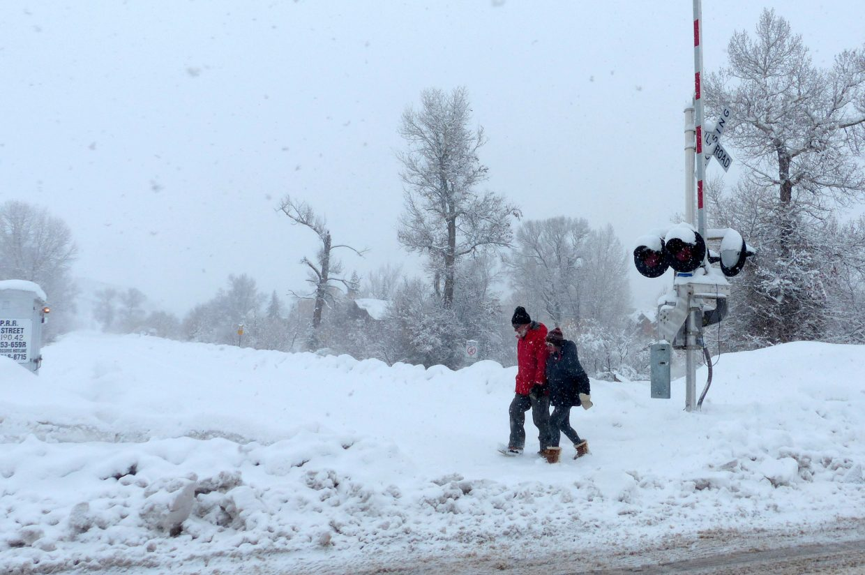 A couple was out walking in the snow and they were on 5th Street and had just crossed the RR tracks.