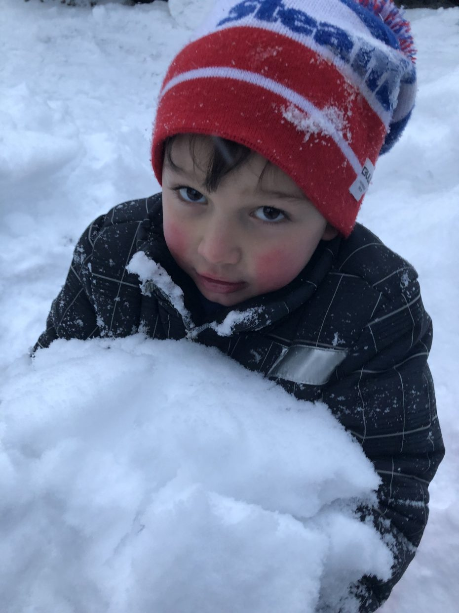 Jack McElfish builds a snowman over the weekend.