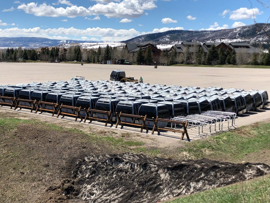 Old gondola cars are arranged in the Meadows Parking lot as Steamboat Resort prepares for construction of a new gondola.