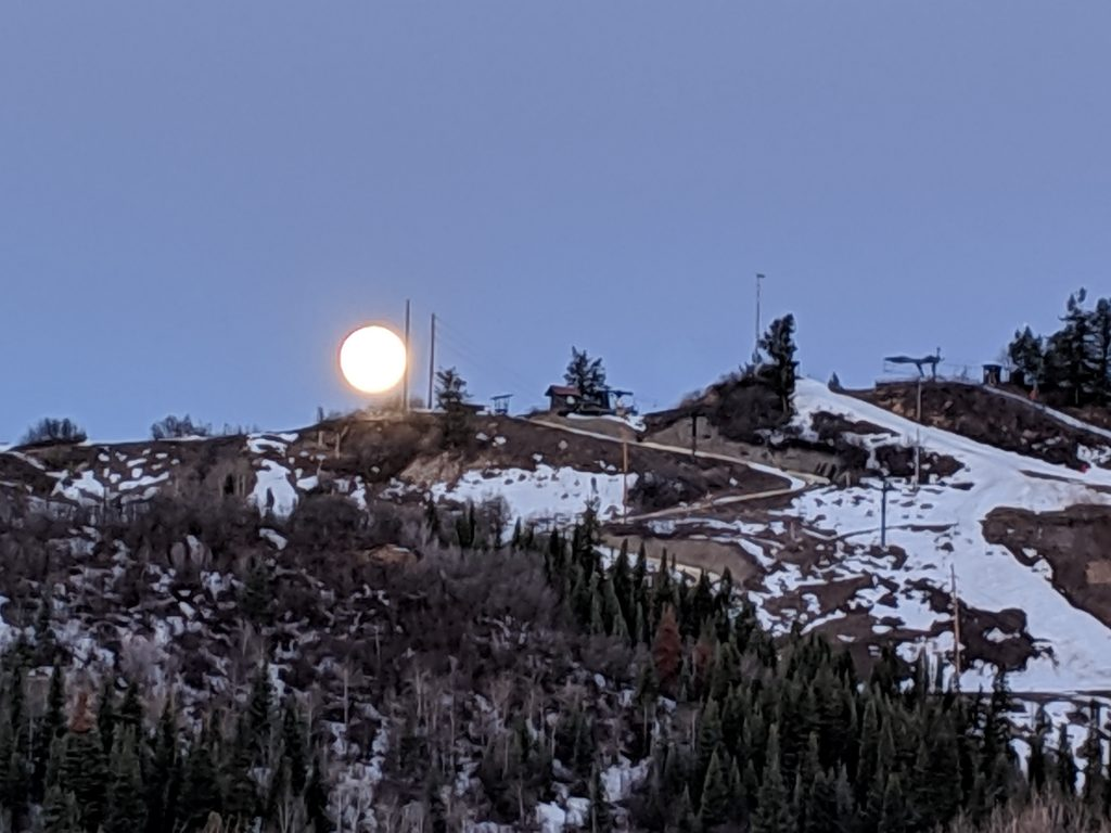 The moon rises over Howelsen Hill in downtown Steamboat Springs.