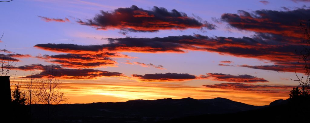 The sunsets over Steamboat Springs, painting the sky in vivid colors.