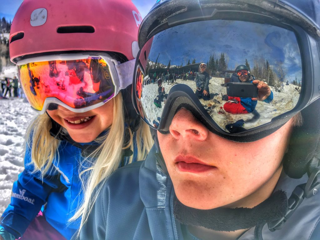Two skiers enjoy a blue bird day at Steamboat Resort.