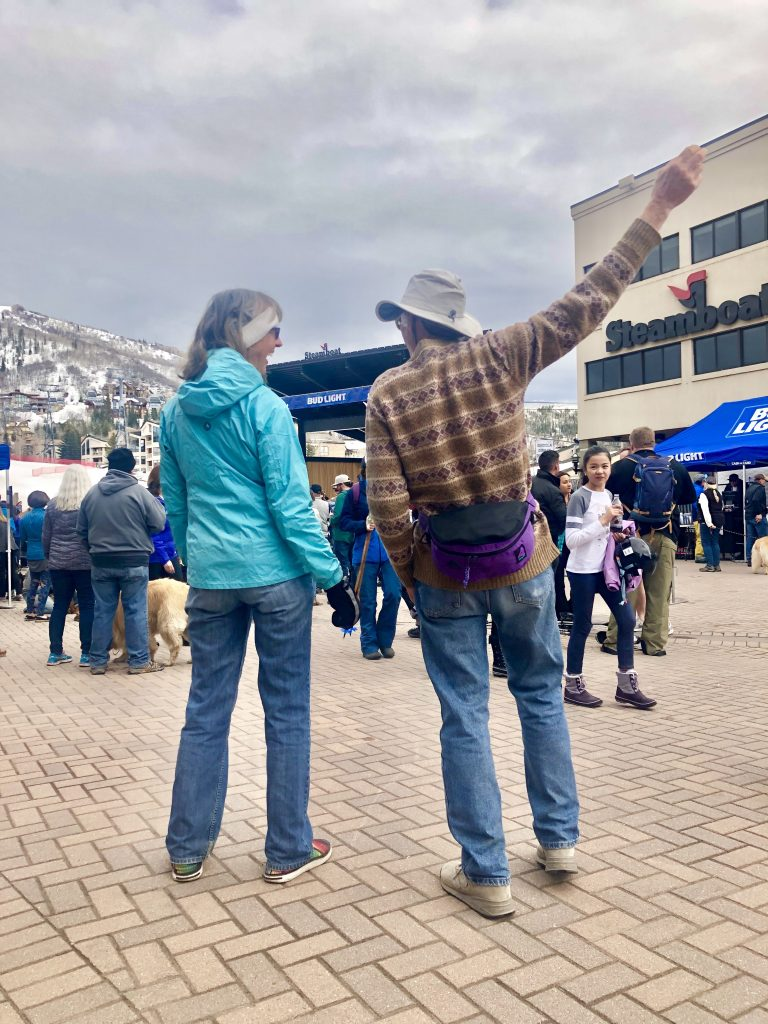 A couple enjoys a concert at the base of Steamboat Resort.