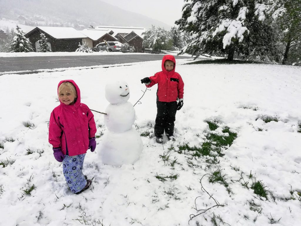 Three-year-old Heidi, left, and 5-year-old Silas enjoy the snow that arrived in Steamboat Springs on Tuesday.