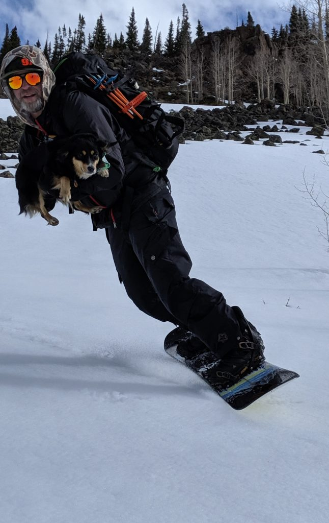 Brian and his dog Rahwah enjoy some snowboarding.