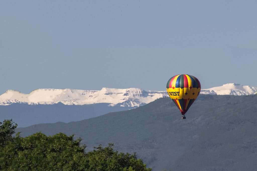 The Wild West hot air balloon finds its way over town.