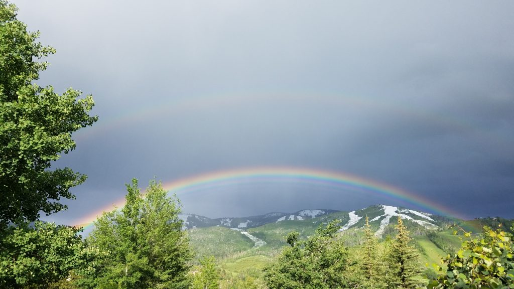 A rainbow appears over Mount Werner.
