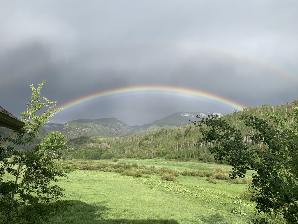A rainbow appears over Fish Creek Falls.