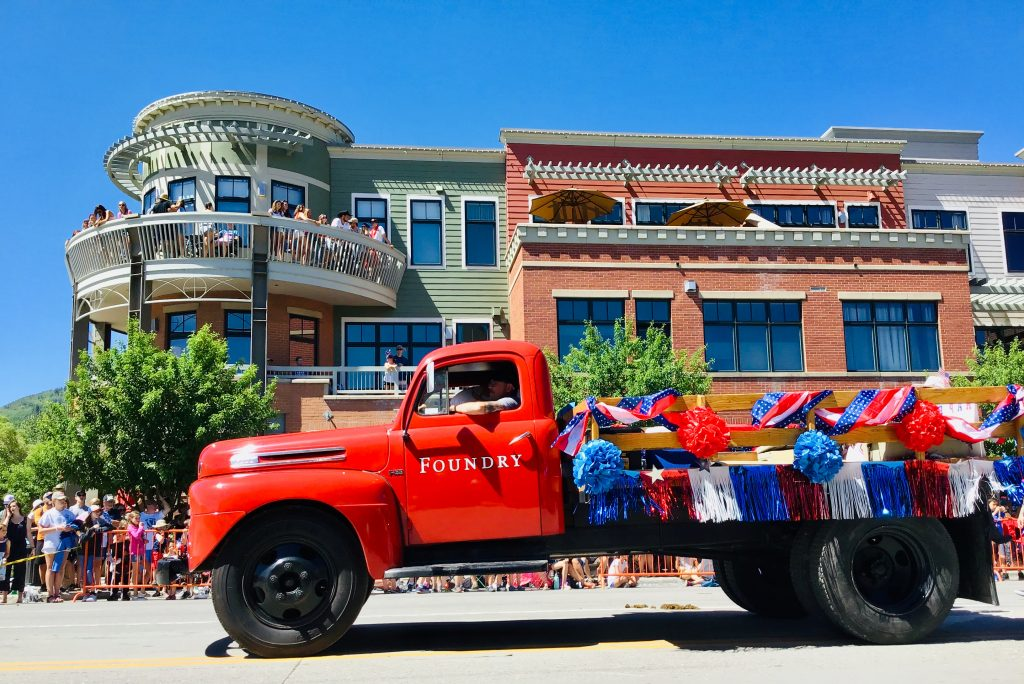 The Foundry truck drives down Lincoln Avenue as part of the Fourth of July Parade in Steamboat Springs.