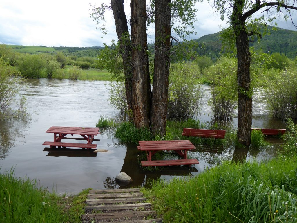 A picnic area along the Yampa River Core Trail finds itself under water.