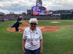Baseball fan, cancer survivor, gets royal treatment at Rockies game