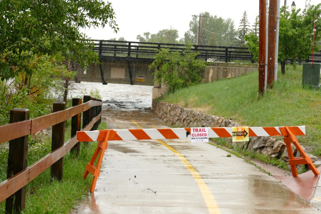 A sign that this portion of the Core Trail under the 13th Street Bridge is closed due to flooding.