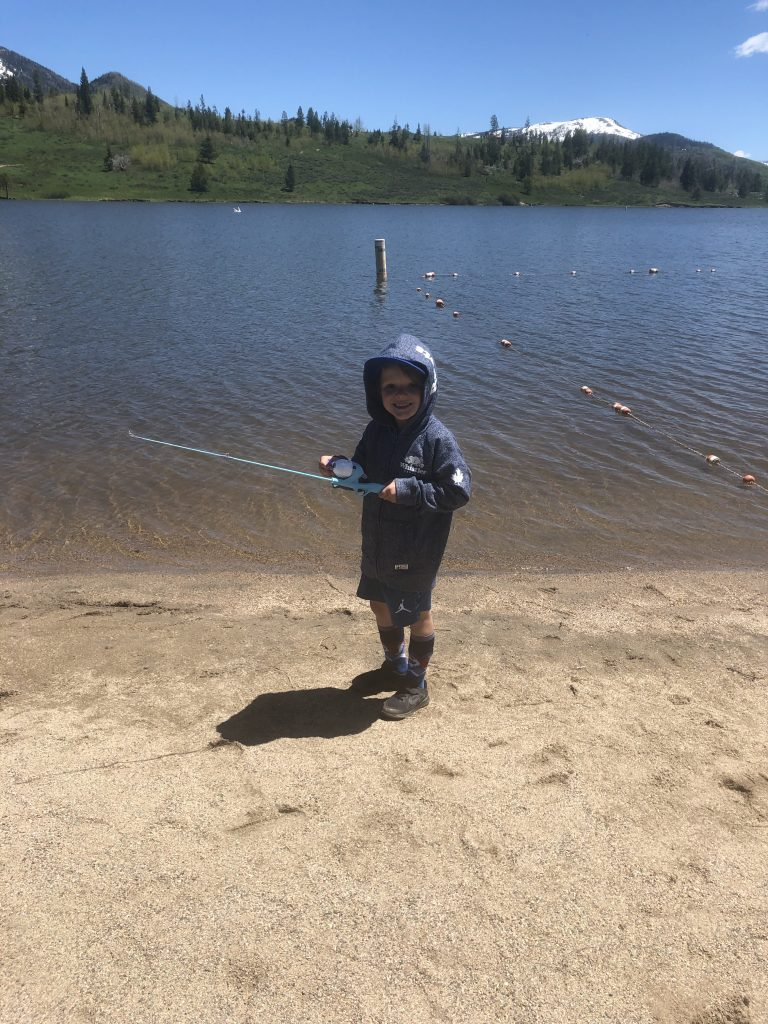 A boy fishes at Steamboat Lake State Park.