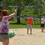 Amanda Dietrich prepares to serve a volleyball in a pickup game with her friends at the Howelsen Hill sand volleyball courts.