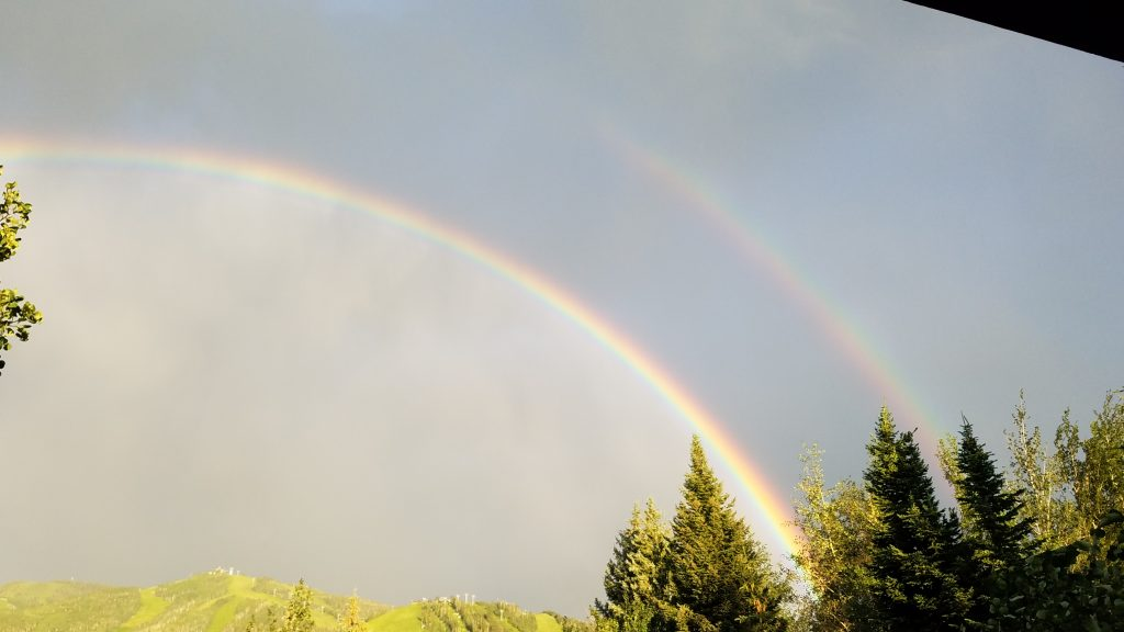 A double rainbow appears after a short rain storm on Monday, July 22.