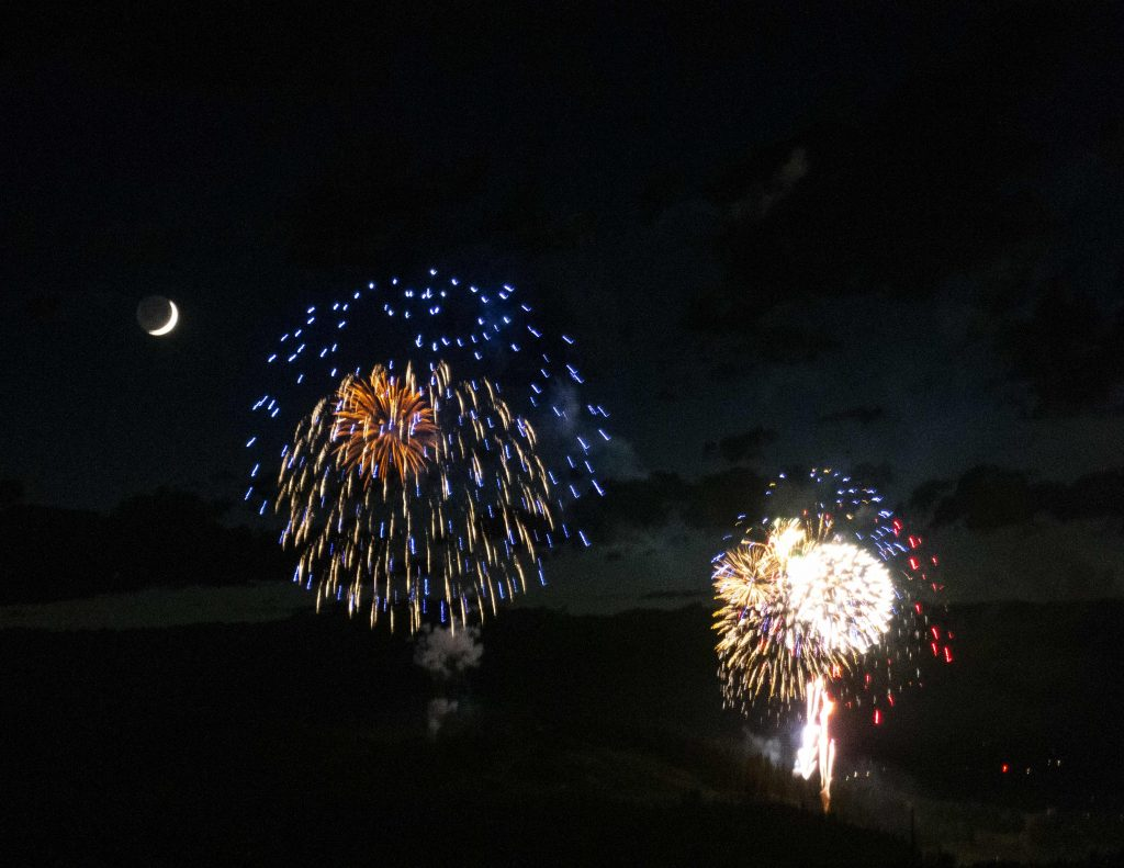 July 4th fireworks and moon in Steamboat Springs